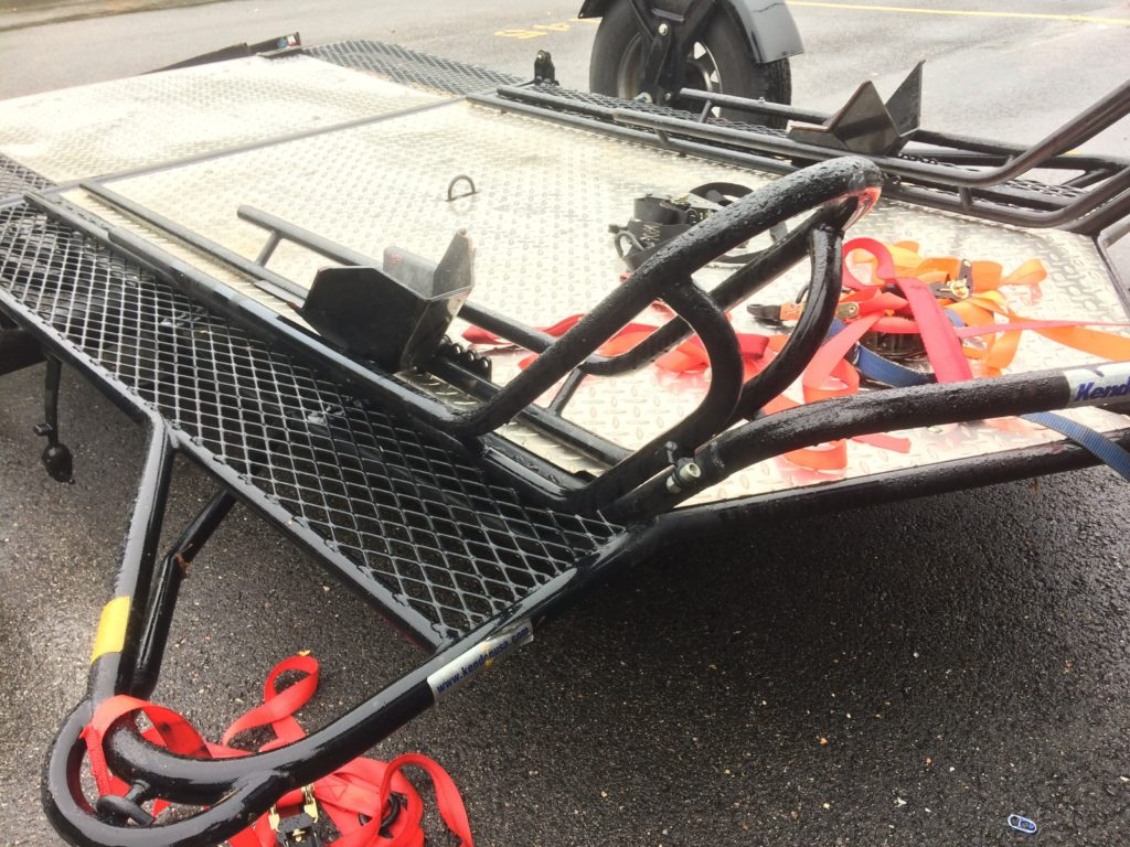 Close up of sled railings on double open motorcycle trailer