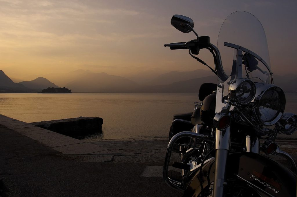 Harley Davidson Motorcycle overlooking a bay and mountains