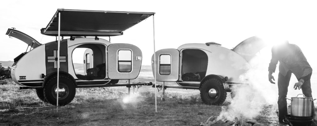 Vintage Overland camper with awning  campsite