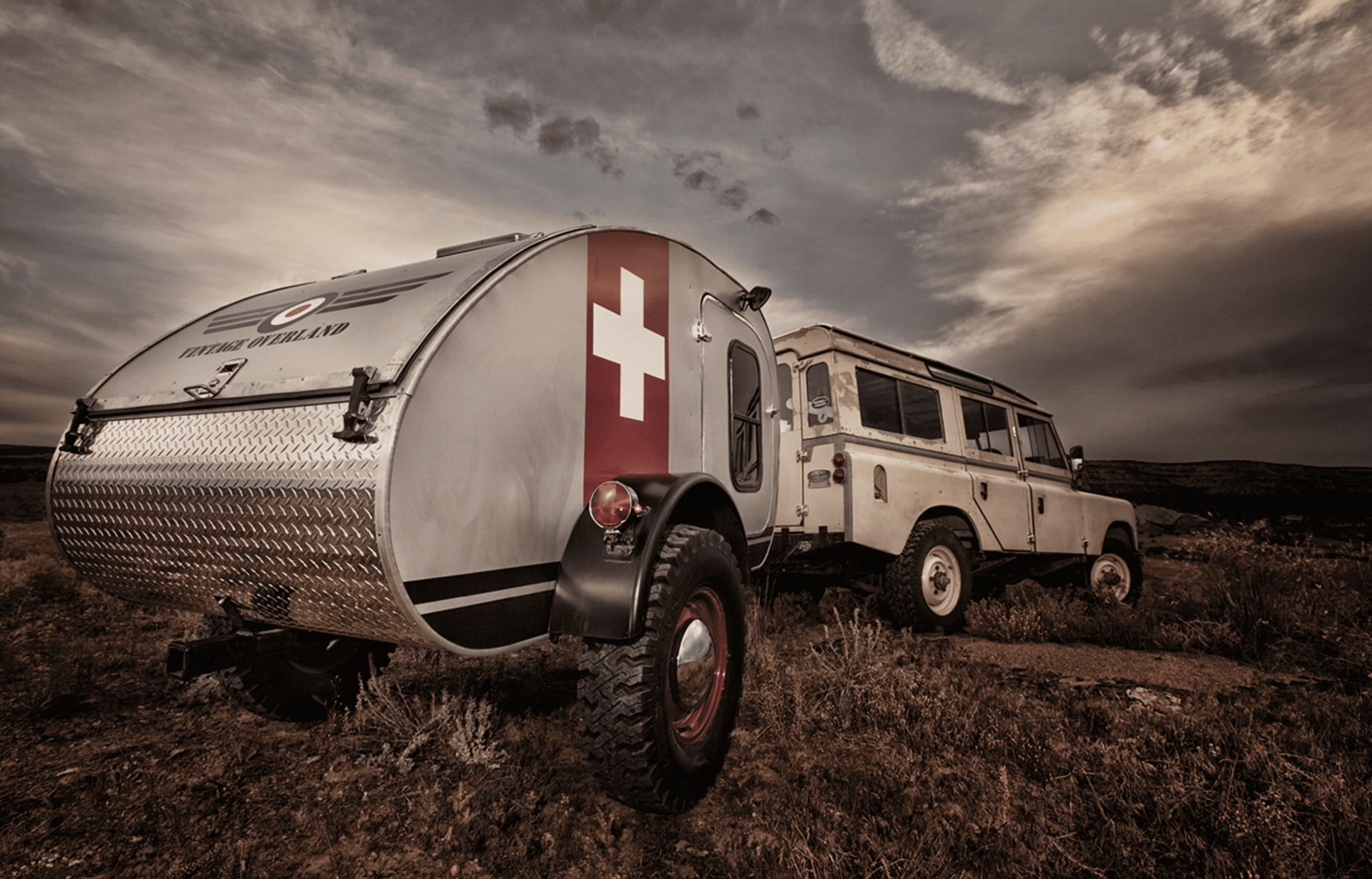 Vintage Overland Teardrop trailer towed by a land rover