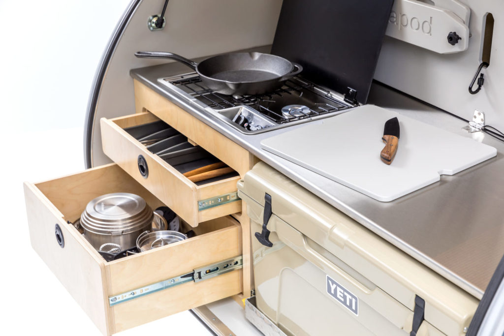 Escapod trailer showing gally kitchen with two burner stove