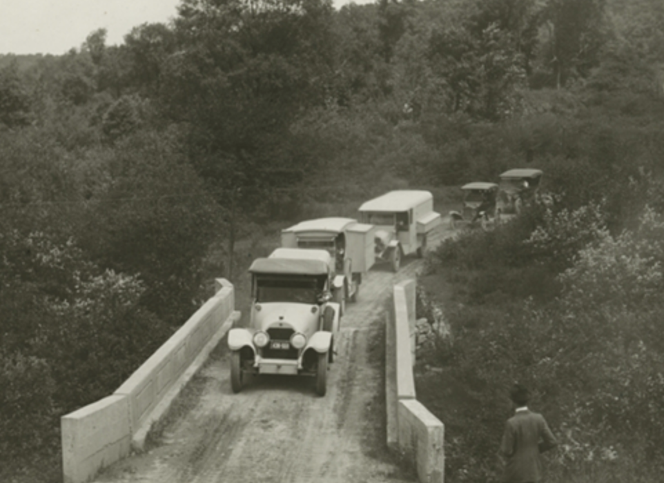1919 caravan of vehicles on dirt road from the four vagabonds