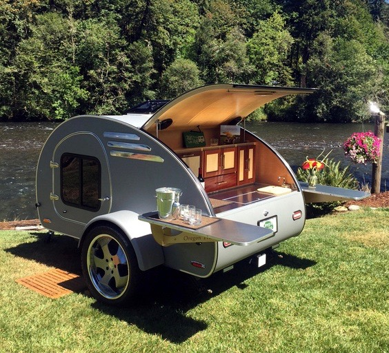 Oregon teardrop trailer: Frontear  Trailer exterior by river