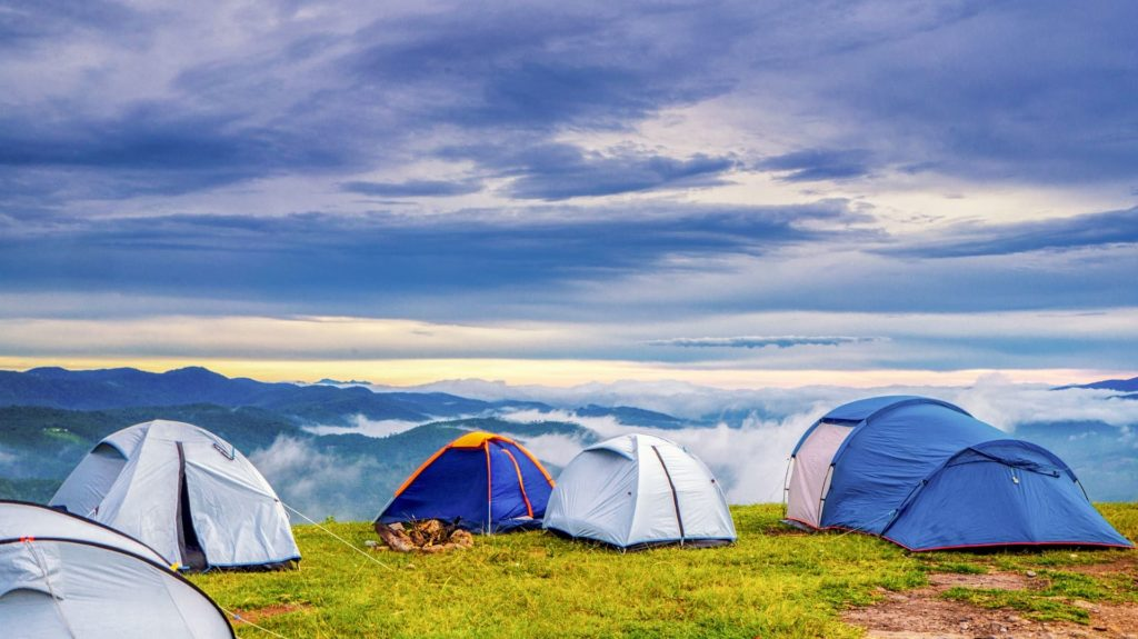 Five beautiful tents overlooking hills and rolling fog