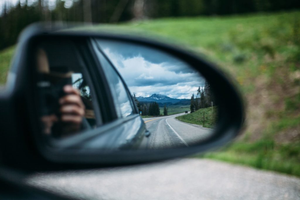 Camera reflected in side mirror and road