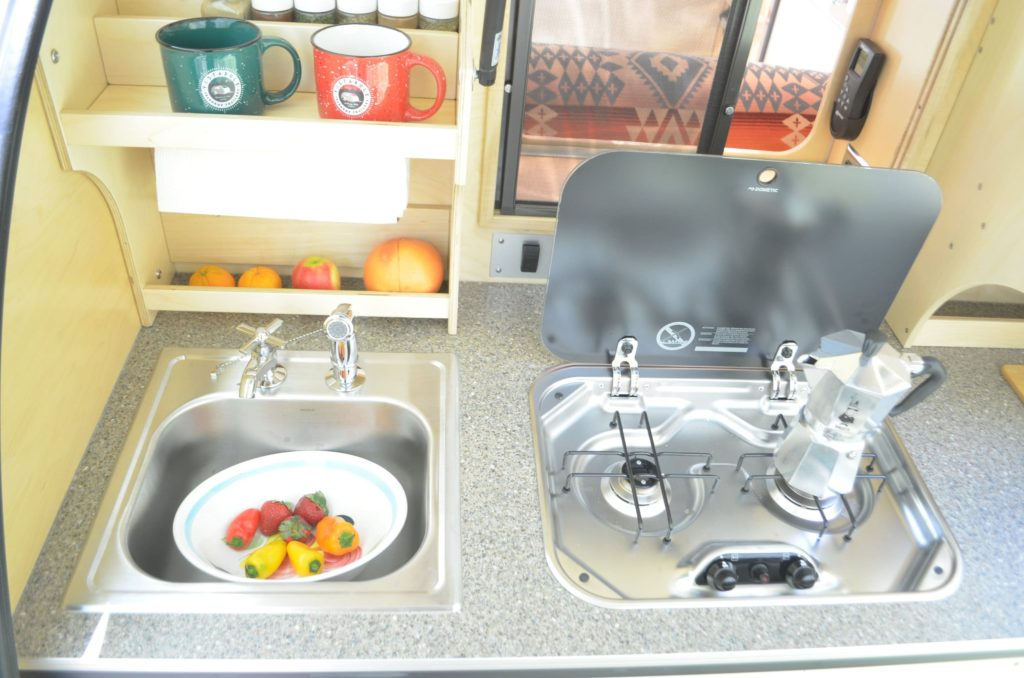 sink and stove top rear galley of teardrop trailer