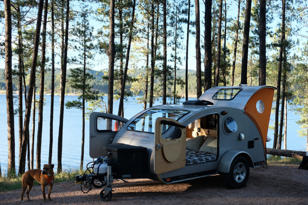 teardrop trailer outside by lake