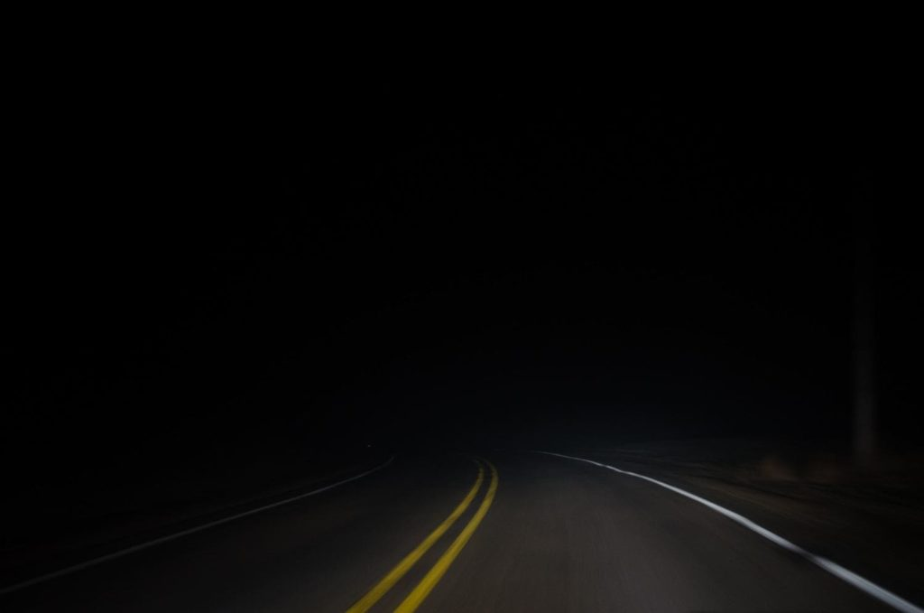 Road leading into complete darkness