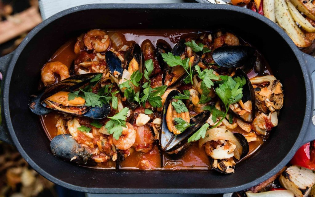 seafood stew in cast iron pot