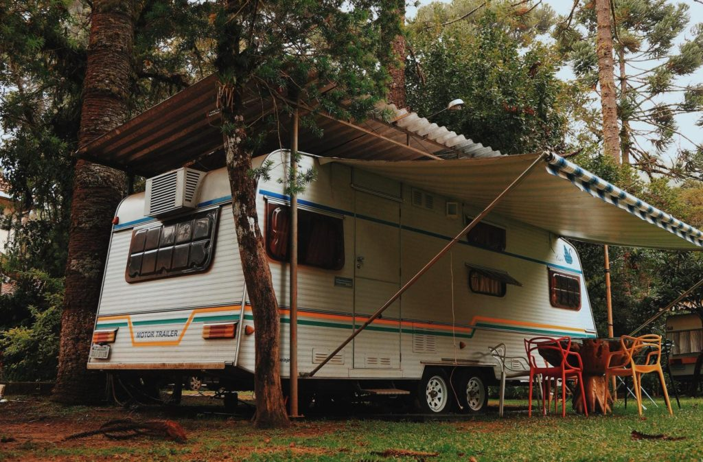 Classic RV w Awning in Forest