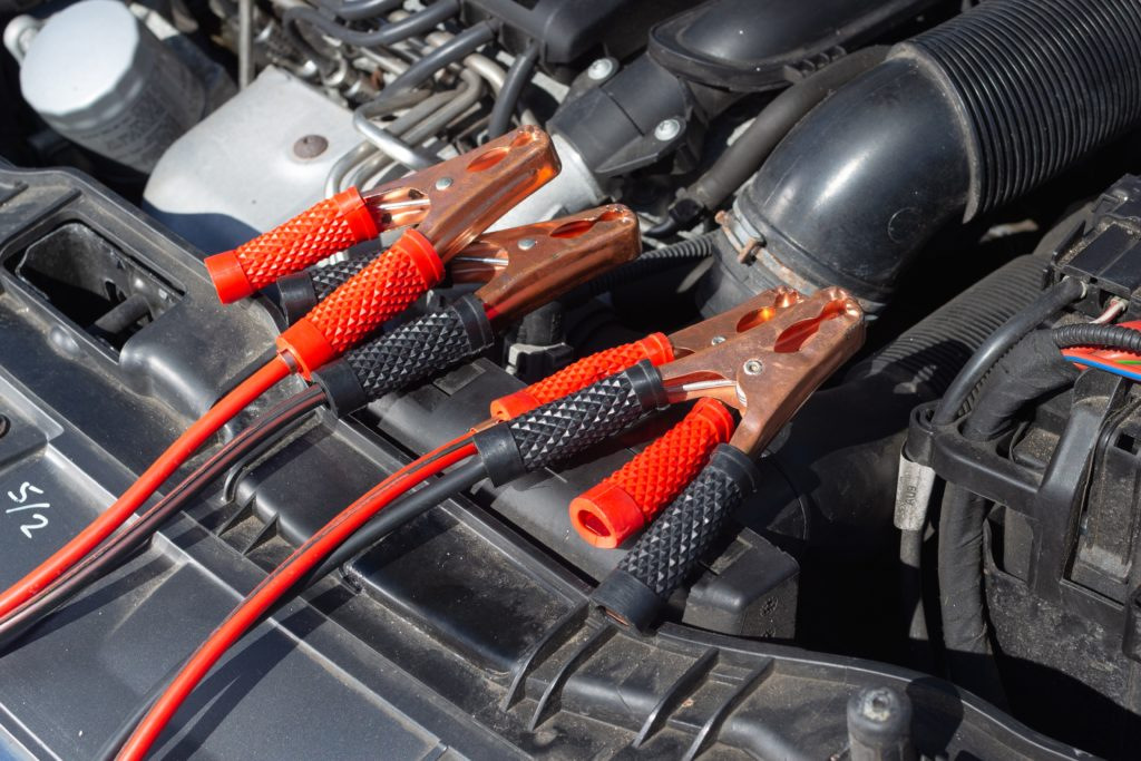 image of jumper cables on an engine